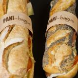 Baguette und Körner-Sandwich mit personalisierten Holzringen